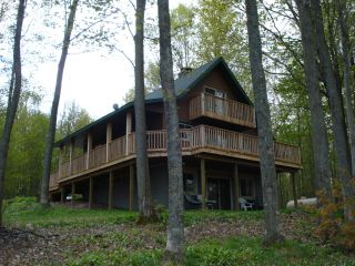 Golf Cabin is located on the 14th fairway on Wildneress Valley Golf Course at Black Forest.